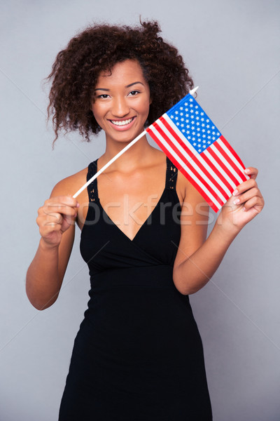 Afro american woman holding USA flag  Stock photo © deandrobot