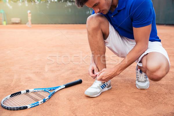 Mannelijke tennisspeler schoenveters buitenshuis gezondheid sport Stockfoto © deandrobot