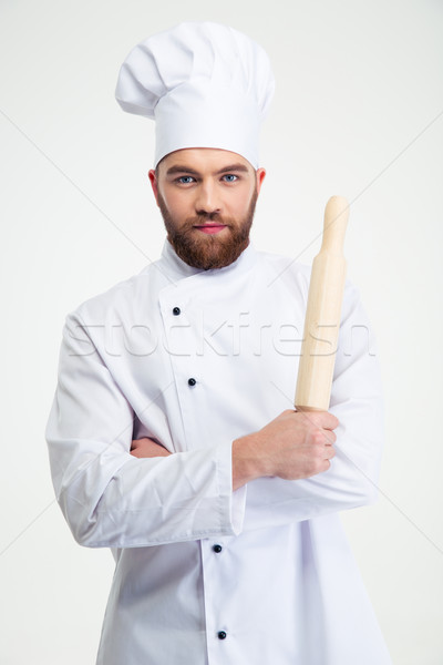 Male chef cook holding a rolling pin Stock photo © deandrobot