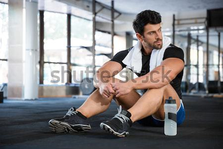 Sportsman doing exercise for arms Stock photo © deandrobot