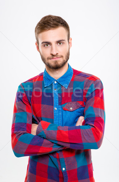 Serious casual man standing with arms folded  Stock photo © deandrobot