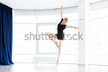 Vonzó boldog fiatal nő rövid fekete ruha tánc Stock fotó © deandrobot