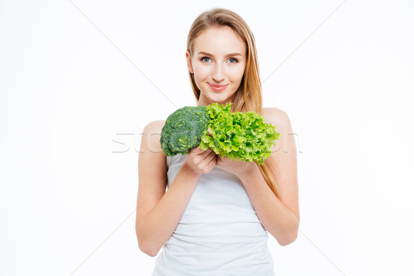 Woman holding cauliflower and green salad Stock photo © deandrobot