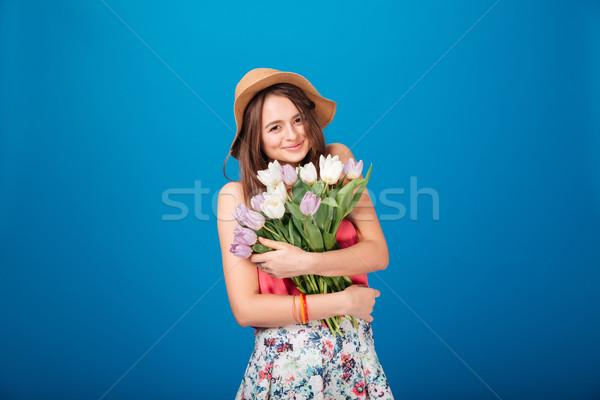 Mosolyog csinos fiatal nő tart virágcsokor virágok Stock fotó © deandrobot