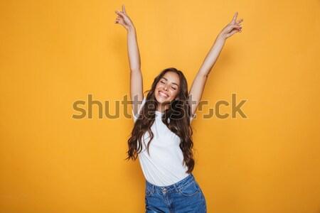 Heiter Frau stehen erhobenen Händen gelb Lächeln Stock foto © deandrobot