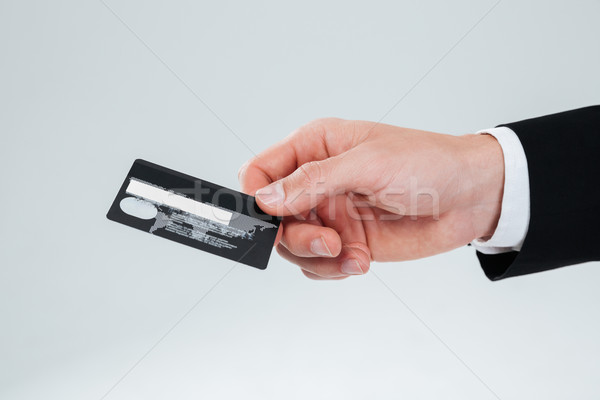 Stock photo: Hand of businessman holding credit card