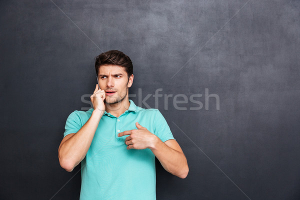 путать красивый молодым человеком Постоянный говорить сотового телефона Сток-фото © deandrobot
