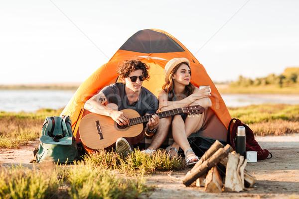 Portre oturma gitar şenlik ateşi mutlu Stok fotoğraf © deandrobot
