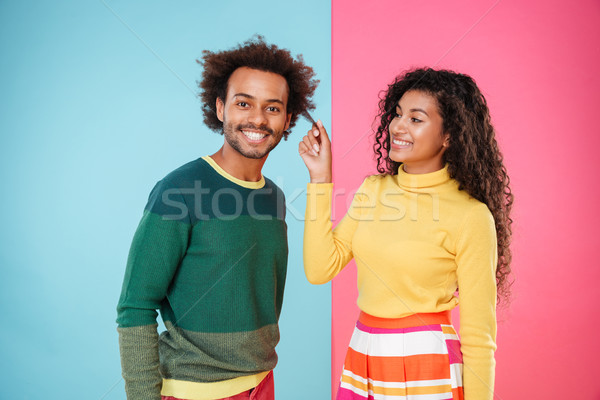 Cheerful african young couple having dun together Stock photo © deandrobot