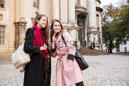 Young girls in coats makes selfie Stock photo © deandrobot