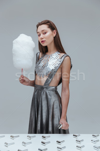 Woman holding cotton candy and old razor blade Stock photo © deandrobot