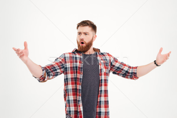 Confident bearded man in plaid shirt singing with arms raised Stock photo © deandrobot