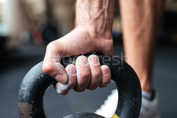 Close up image of fitness hand and kettlebell Stock photo © deandrobot