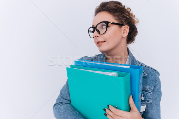 Woman in jean jacket holding folders Stock photo © deandrobot