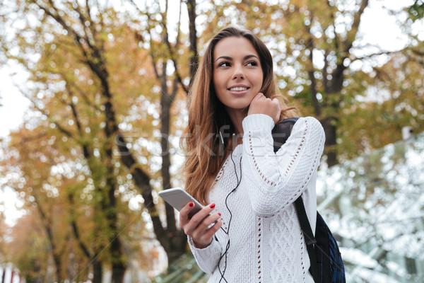 счастливым женщину сотового телефона очаровательный Сток-фото © deandrobot