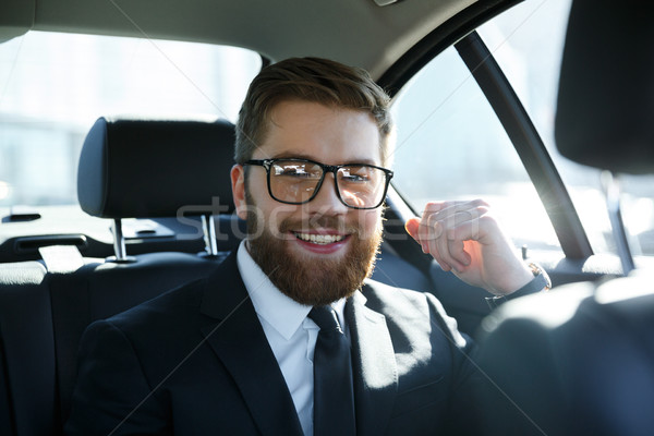 Man sitting at the back seat of a car Stock photo © deandrobot