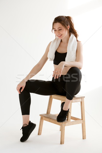 Cheerful sports lady sitting with towel Stock photo © deandrobot