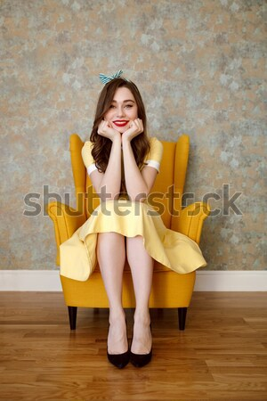Vertical image of Uncomprehending woman on armchair Stock photo © deandrobot