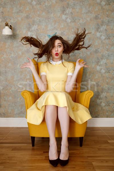 вертикальный изображение смешные женщину кресло желтый Сток-фото © deandrobot