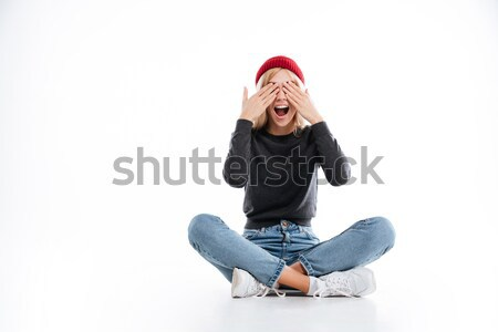 Happy female hipster covering her eyes Stock photo © deandrobot