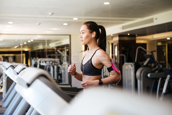 Young amazing fitness woman Stock photo © deandrobot