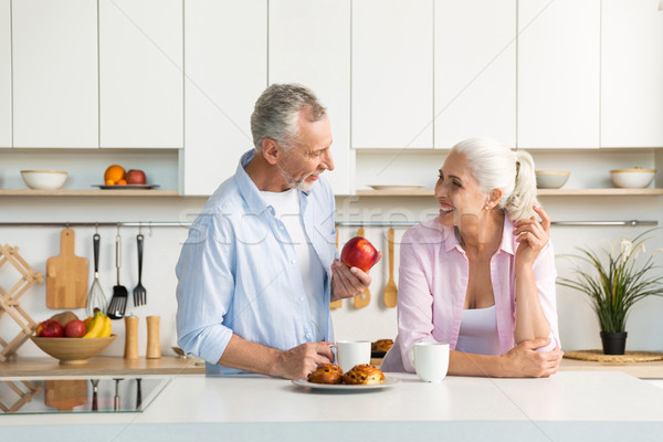 Mature loving couple family standing at the kitchen Stock photo © deandrobot