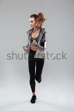 Afbeelding jonge sport vrouw lopen Stockfoto © deandrobot