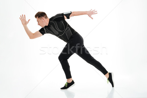 Full length portrait of a healthy sportsman started to run Stock photo © deandrobot