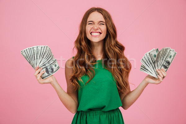 Portrait of a satisfied happy woman winner with long hair Stock photo © deandrobot