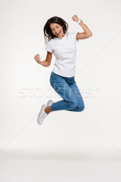 Portret dość radosny kobieta skoki Zdjęcia stock © deandrobot