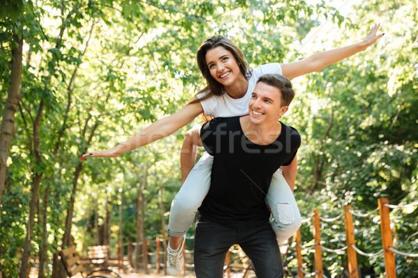 Fiatal mosolyog pár élvezi háton nevet Stock fotó © deandrobot