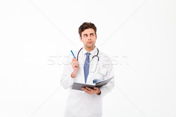 Portret nadenkend jonge mannelijke arts stethoscoop uniform Stockfoto © deandrobot