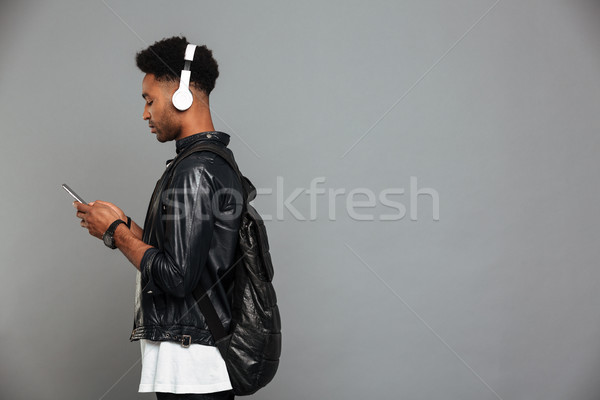 Portrait of a young afro american man in headphones Stock photo © deandrobot