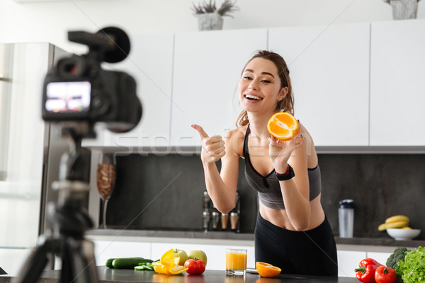 Smiling healthy young girl recording her video blog Stock photo © deandrobot