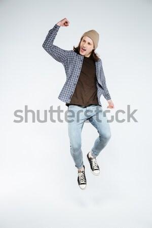 Vertical imagen alegre mujer denim ropa Foto stock © deandrobot