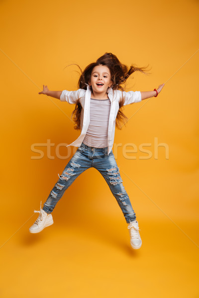 Excited little girl child jumping Stock photo © deandrobot