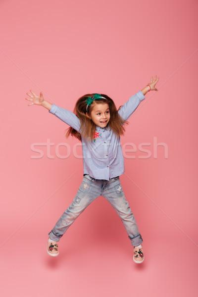 фотография радостный беззаботный ребенка прыжки Сток-фото © deandrobot