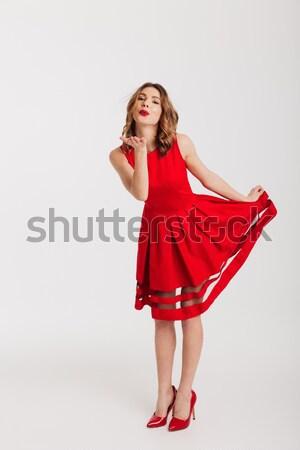 Ritratto vestito rosso posa piedi Foto d'archivio © deandrobot