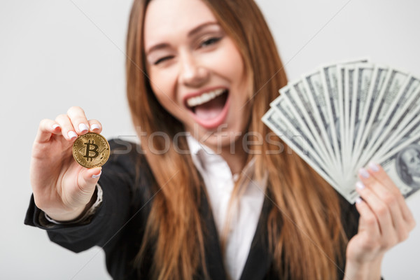 Souriant femme bitcoin dollars Photo stock © deandrobot