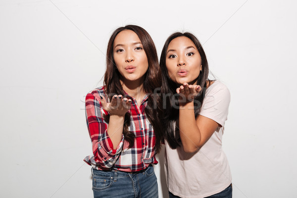 Two asian pretty ladies sisters Stock photo © deandrobot