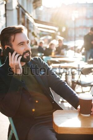 Stock photo: Portrait of a stylish bearded man using mobile phone