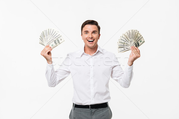 Portrait of a cheerful successful man in white shirt Stock photo © deandrobot