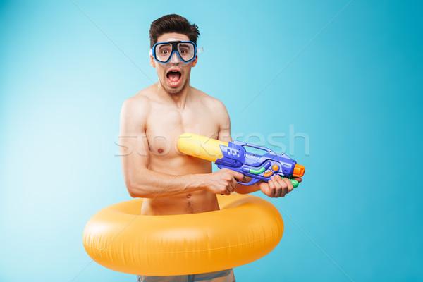 Retrato alegre jóvenes sin camisa hombre nadar Foto stock © deandrobot