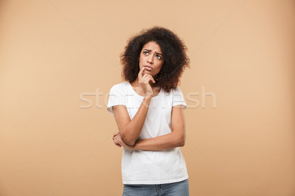 Portrait of a pensive young african woman looking away Stock photo © deandrobot
