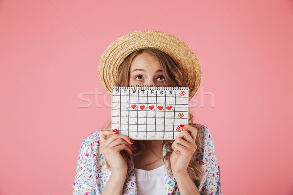 Portrait of a pretty young woman in straw hat Stock photo © deandrobot