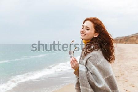 Smiling young sportswoman Stock photo © deandrobot