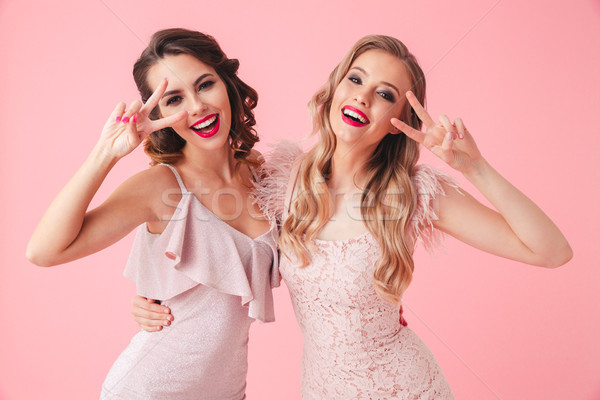 Two funny women in dresses having fun together Stock photo © deandrobot