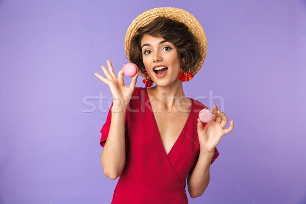 смешные брюнетка женщину платье соломенной шляпе еды Сток-фото © deandrobot