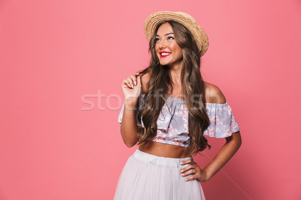 Portrait of positive glamour woman 20s wearing straw hat smiling Stock photo © deandrobot