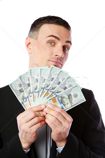 Handsome businessman holding US dollars isolated on a white background Stock photo © deandrobot